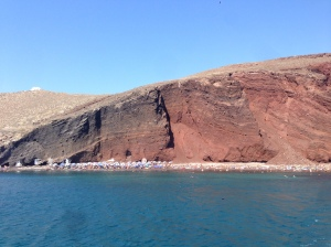 The red sand beach via our boat